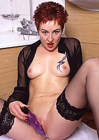 Horny MILF with naked pussy plays with purple toy