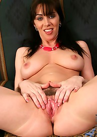 Anilos model rayveness licks her glass toys before she thrust it between her eye catching boobs