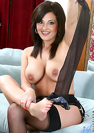 Beautiful and busty housewife strips off her clothes