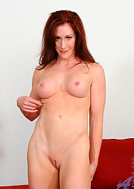 Catherine Desade pleasures her shaved milf pussy in her office