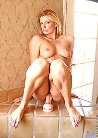 Anilos leggy milf Darryl Hanah straddles the suction cup dildo and rides it until her pussy is content
