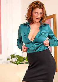 Classy Anilos woman unbuttons her blouse exposing her cleavage