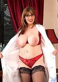 Pretty cougar nurse shows off her massive cleavage
