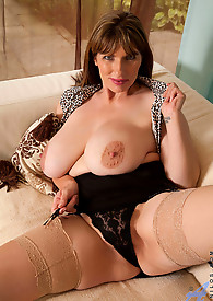 Thick cougar with big tits slides off her panties